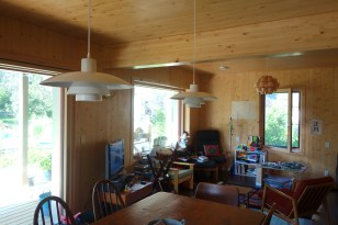 A pair of Poul Henningsen's PH 4/3 pendants over the dining table