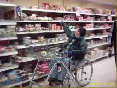 Trying to reach top shelf from the wheelchair