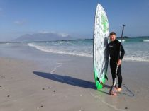 Trying a bit of stand up paddle surfing... its not quite the Thames!