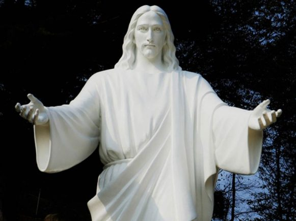 Bronze statue of the Holy Son painted white
