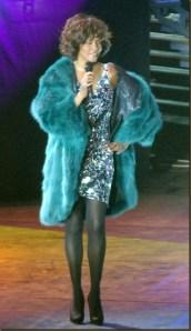 Whitney Houston wearing reversible fox fur coat.