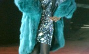 Whitney Houston wearing reversible emerald green fox fur coat.