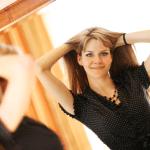 woman looking in mirror by Fotolia