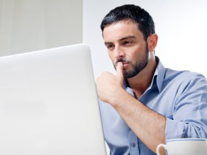 Young Man with Beard working on Laptop