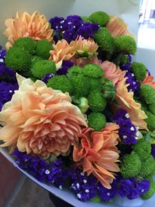 Orange, green and purple flowers that I bought to take to a friends for dinner.