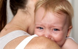 Recropped crying baby mom