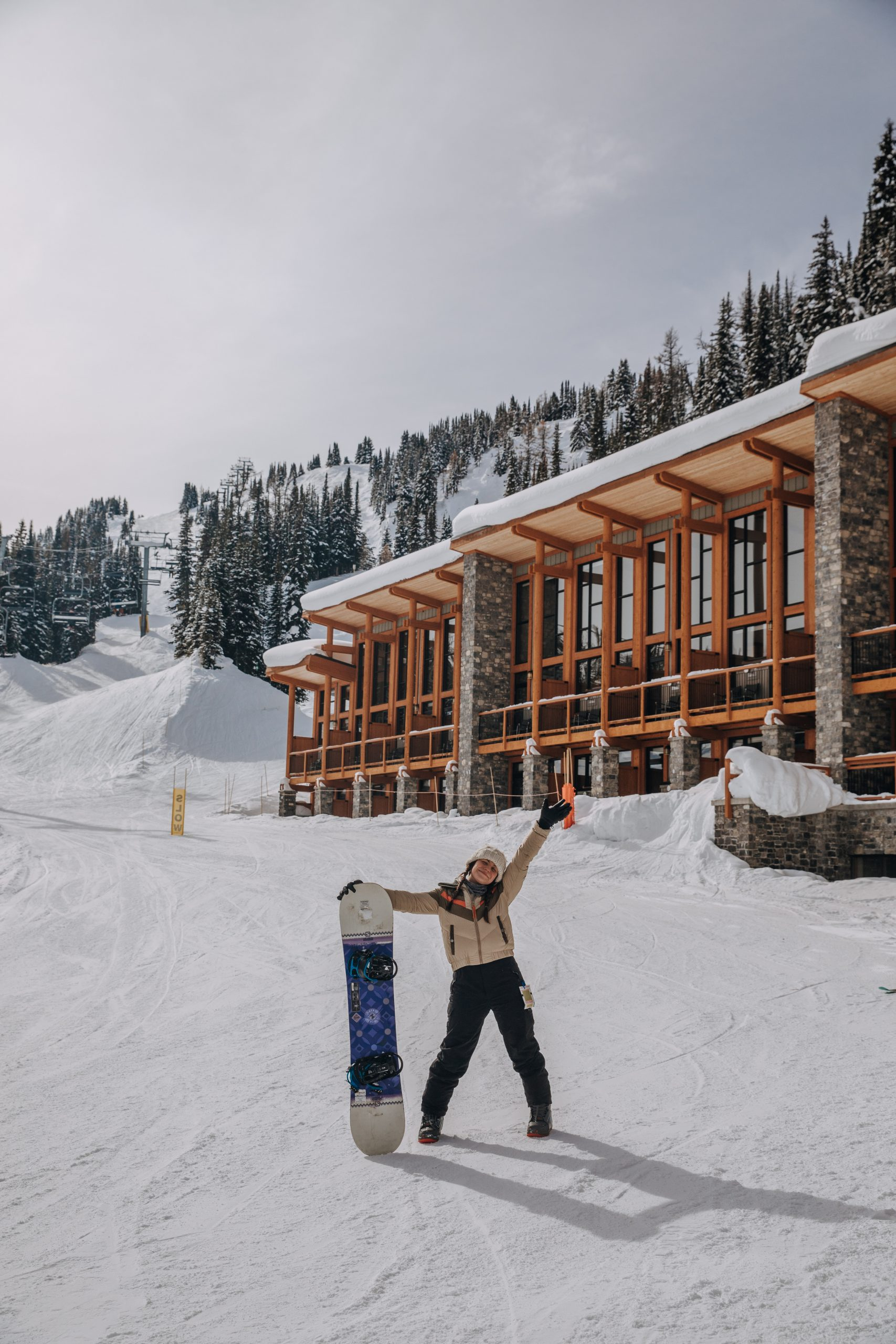 The Ultimate Banff Winter Guide - girl snowboarding in Banff
