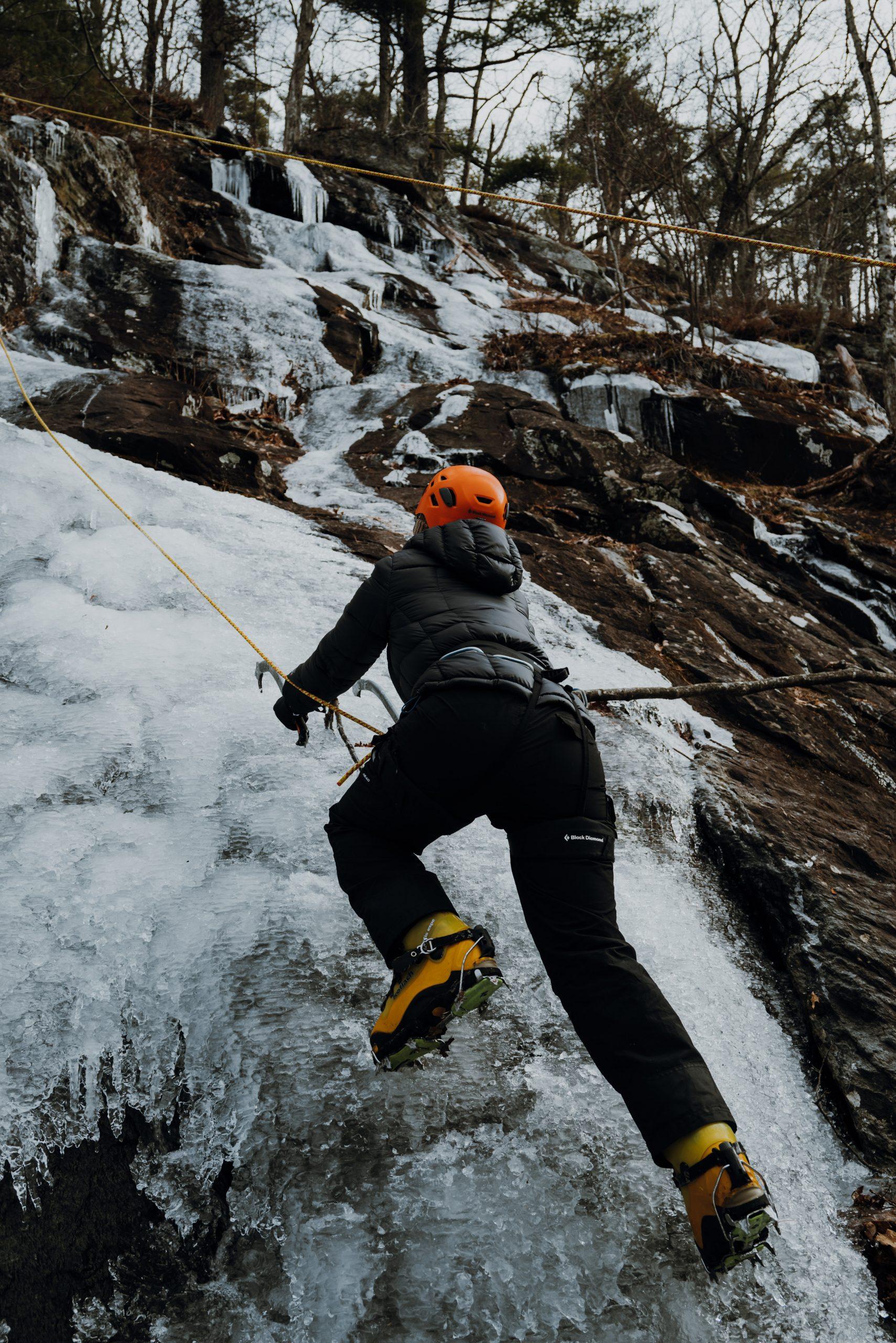 Girl Ice Climbing in Maine