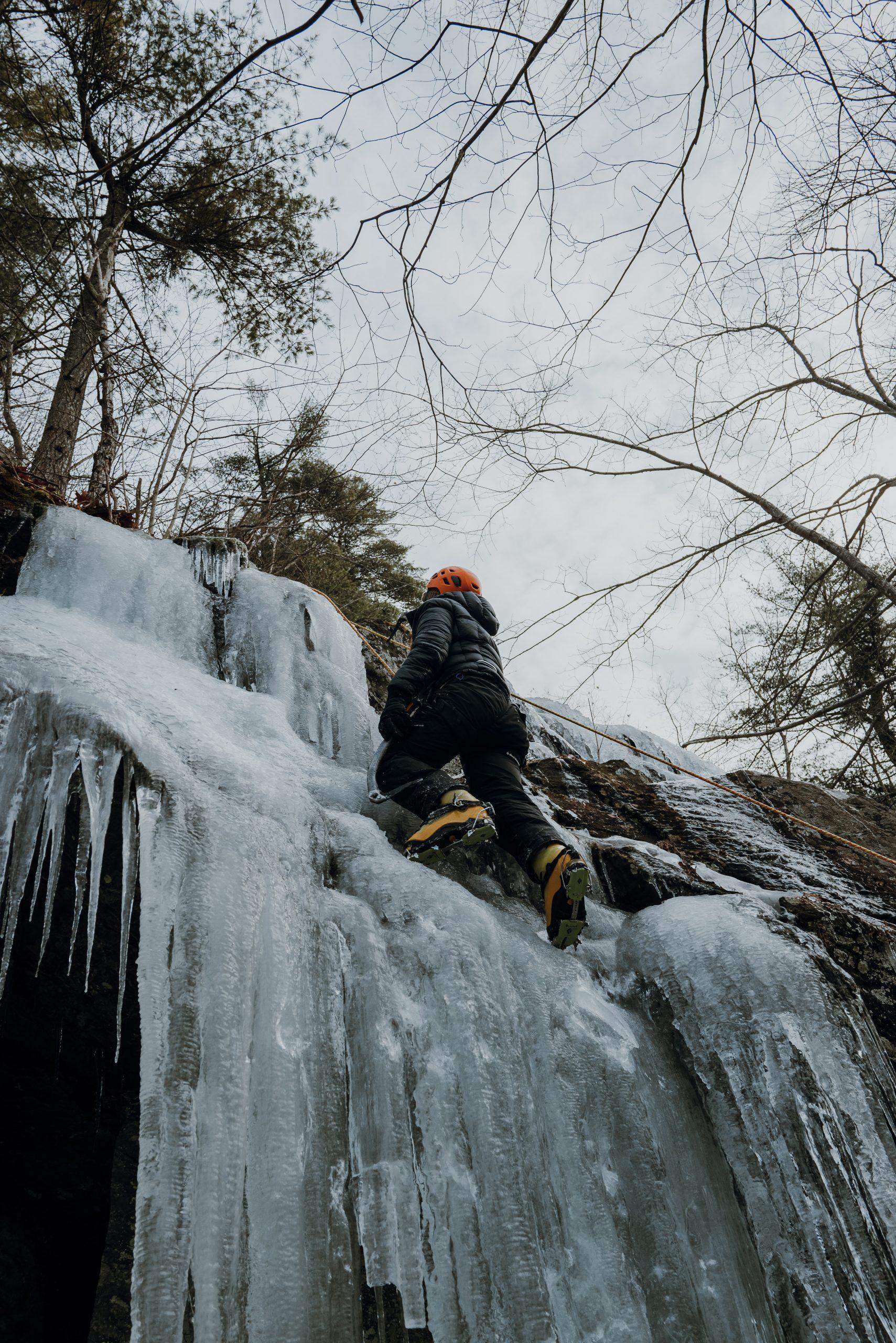 Girl Ice Climbing in Camden Maine