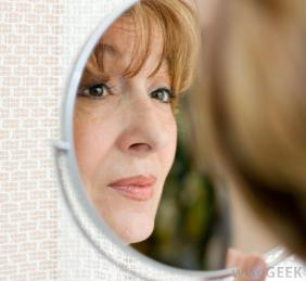 woman in mirror - source wisegeek