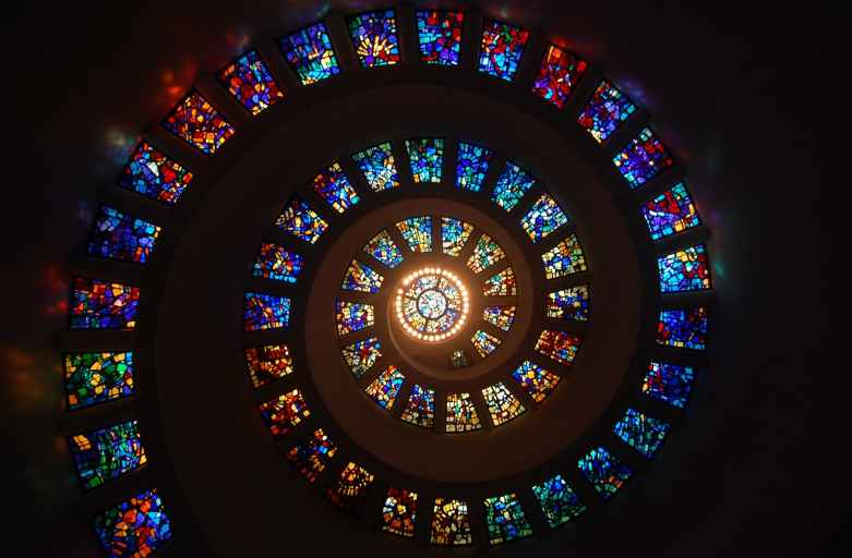 worms eye view of spiral stained glass decors through the roof