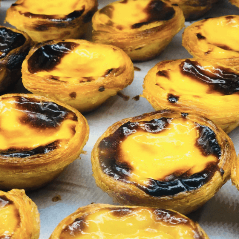 Several Pasteis de Nata for sale in Portugal