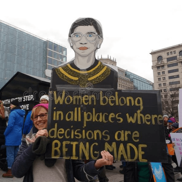 Woman with RBG Sign