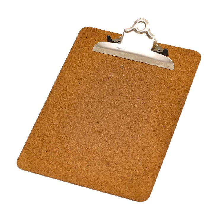 Wooden clipboard with a metal clip at the top. Photo is taken at an angle.