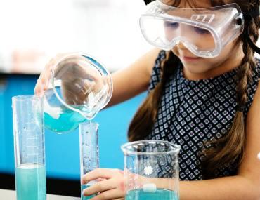 Girl doing experiment