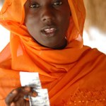 Burundi woman with condoms