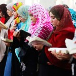 Muslim women reading from Quran