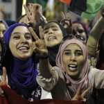 Libyan women celebrating and giving the peace sign