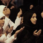 Women praying outside Bahrain hospital