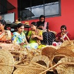 Women weaving baskets