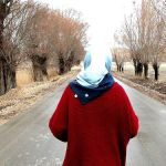 An Iranian elder woman walks alone