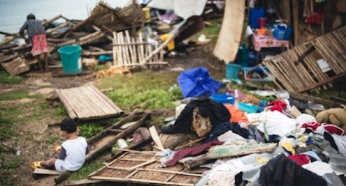 """PHILIPPINES: """"We don't want to move,"""" say families after Typhoon Haiyan destruction"""