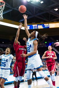 Kennedy Burke gets the rebound as teammate Monique Billings looks on. Photo by Percy Anderson.
