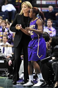 Coach Katie Abrahamson-Henderson talks with Imani Tate on the sidelines. Photo by Bill Ziskin.
