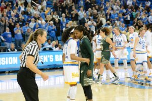 UCLA guard Jordin Canada gives South Florida guard Courtney Williams a hug after the Bruins beat the Bulls in the NCAA Tournament second round Monday. Photo by Nicc Jackson.