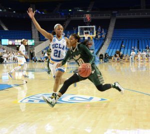 Courtney Williams drives to the basket as Nirra Fields defends. Photo by Nicc Jackson.