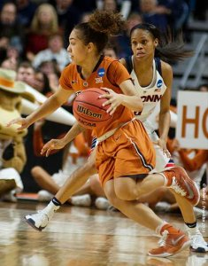 Texas's Brooke McCarty (11) changes direction on UConn's Moriah Jefferson (4) and get the ball to one of her teammates for another assist. Photo by Robert L. Franklin.
