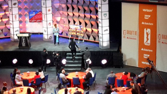 Courtney Walker gets a hand to the stage after being selected. Photo by Rebecca Rider.
