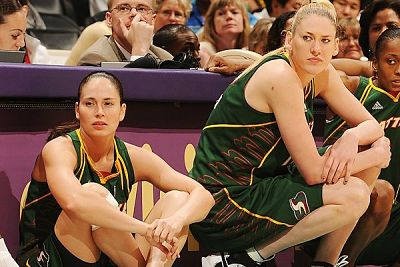 Sue Bird and Lauren Jackson wait to enter the game. Photo courtesy of Storm Basketball.
