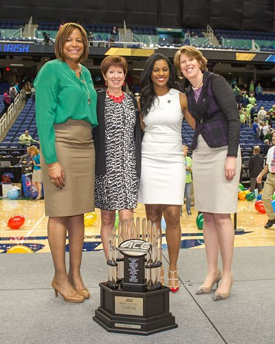 Notre Dame coach Muffet McGraw, second from left, with associate head coach Carol Owens and associate coaches Niele Ivey and Beth Cunningham. McGraw has had an all-female coaching staff since 2012. Photo by Mike Bennett.