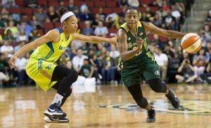 Jewell Loyd takes on Aerial Powers. Loyd lead the Storm with 24 points and Powers headed up the Wings' efforts with 19. Photo by Neil Enns/Storm Photos.