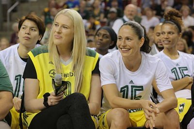 Lauren Jackson and Sue Bird listen to speakers honor Jackson at her jersey retirement ceremony after Friday's game. Photo by Stormbasketball.