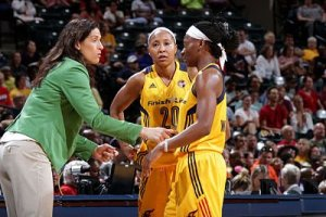 Stephanie White talks with Briann January and Erica Wheeler. Photo by Ron Hoskins/NBAE via Getty Images.