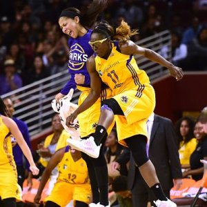 Candace Parker and Essence Carson  celebrate a three-pointer after a timeout Photo by Harry How/Getty Images.