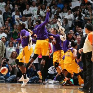 The Sparks bench erupts after Alana Beard's shot sailed through the net. Photo by David Sherman/NBAE Getty Images.