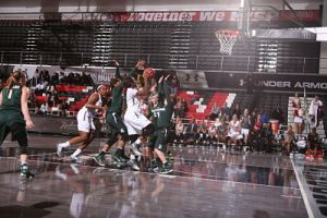 Nautica Morrow drives to the basket. Photo by Jeff Golden.
