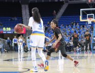 Jordin Canada contemplates getting the ball past former high school teammate Courtney Jaco. Photo by Benita West, TGTVSports1.