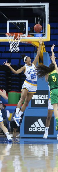Monique Billings elevates to try and stop Maite Cazorla's shot. Photo by Marvin Jimenez/TG SportsTV1.