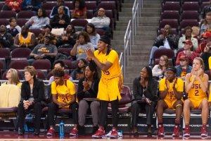 Kristen Simon encourages teammates from the sidelines. Photo by John McGillen.