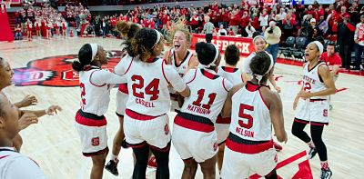 The Wolfpack celebrates their upset of Notre Dame earlier this season. Photo courtesy of NC State Athletics.