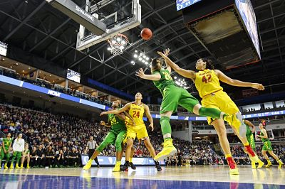 Oregon's Sabrina Ionescu gets past Stephanie Jones to score. Photo courtesy of Oregon Athletics.