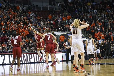 Stanford players exult as the final buzzer sounds. Photo by Eric Evans.