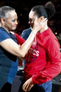 League president Lisa Borders and Kristi Toliver have a moment during the ring ceremony. Photo by Maria Noble/WomensHoopsWorld.