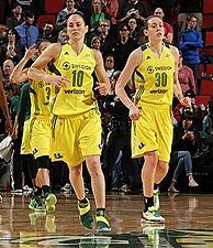Sue Bird and Breanna Stewart jog back on court after a timeout. NBAE/Getty Images photo by Joshua Huston.