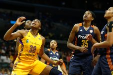 Nneka Ogwumike, Jonquel Jones and Alyssa Thomas prepare to rebound. Photo by Maria Noble/WomensHoopsWorld.