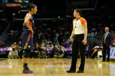 Alyssa Thomas discusses a call with an official. Photo by Maria Noble/WomensHoopsWorld.